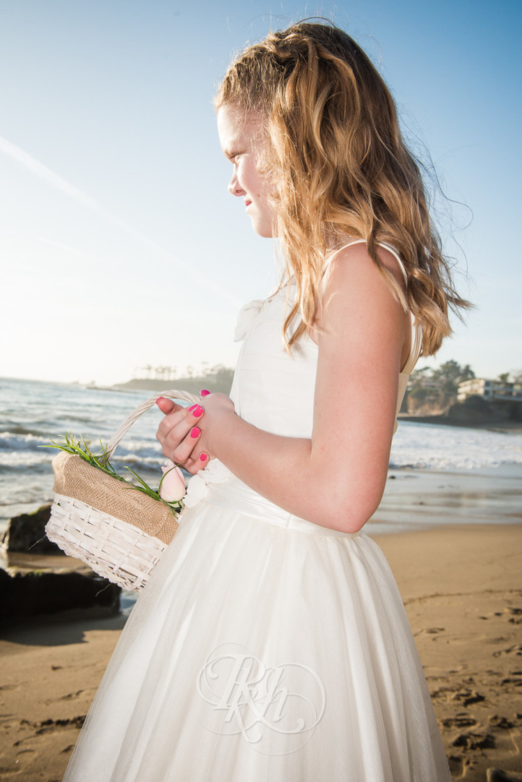 Flower girl at beach wedding